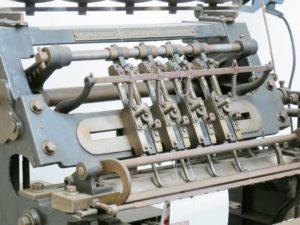 Moderne bogbindings maskine